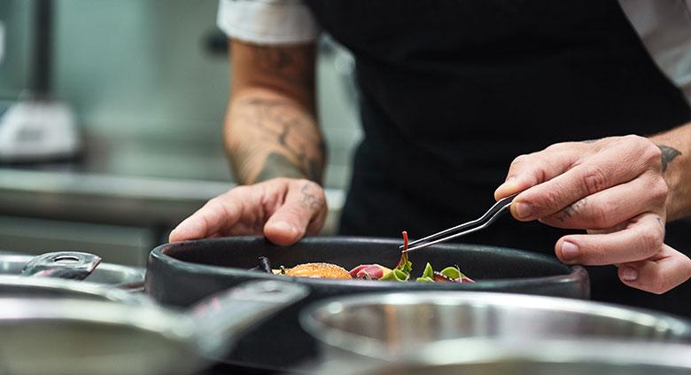 Chef presenting a salad